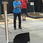 Erle Fraser throwing the opening shoes.